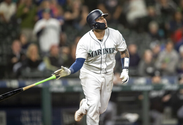 FILE - In this Sept. 14, 2019, file photo, Seattle Mariners' Omar Narvaez tosses his bat after hitting a solo home run off Chicago White Sox relief pitcher Alex Colome during the 10th inning of a baseball game, in Seattle. The Milwaukee Brewers acquired catcher Omar Narváez from the Seattle Mariners on Thursday, Dec. 5, 2019, for minor league pitcher Adam Hill and a compensation round pick in next June's amateur draft. (AP Photo/Stephen Brashear, File)