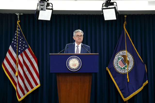 FILE - In this March 3, 2020 file photo, Federal Reserve Chair Jerome Powell speaks during a news conference to discuss an announcement from the Federal Open Market Committee, in Washington.  The Federal Reserve said Friday, April 24,  it had $85.8 billion in loans outstanding last week in three of the programs it rolled out last month to protect the economy during the coronavirus pandemic.   (AP Photo/Jacquelyn Martin, File)