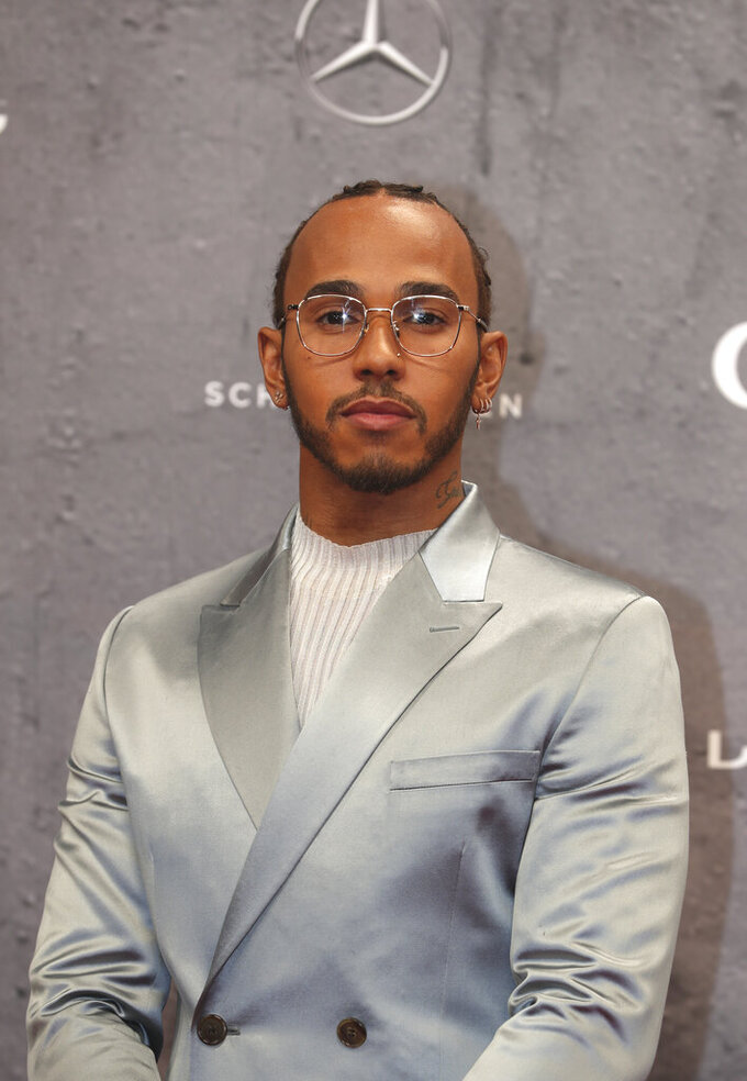 British reigning F1 drivers champion Lewis Hamilton arrives for the 2020 Laureus World Sports Awards in Berlin, Germany, Monday, Feb. 17, 2020. (AP Photo/Michael Sohn)