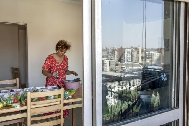 Basma Mostafa, a 30-year-old journalist who founded an initiative that sends freshly home cooked meals to quarantined coronavirus patients, package food at her friend's apartment, in Cairo, Egypt. Saturday, July 11, 2020.  Mostafa, who works with others to coordinate the volunteer effort, said she got the idea of helping out when she was going through a difficult time.