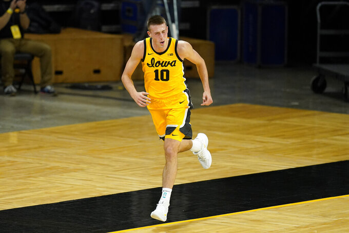 Iowa guard Joe Wieskamp reacts after making a 3-point basket during the first half of an NCAA college basketball game against North Carolina, Tuesday, Dec. 8, 2020, in Iowa City, Iowa. (AP Photo/Charlie Neibergall)