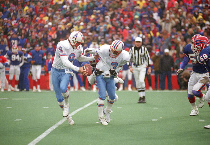 FILE - In this Jan. 3, 1993, file photo, Houston Oilers kicker Al Del Greco (3) and holder Greg Montgomery (9) juggle the ball after an aborted field goal attempt during the fourth quarter of their game against the Buffalo Bills, at Rich Stadium in Orchard Park, N.Y. The Bills, down by 32 points earlier in the game, beat the Oilers 41-38 in overtime. (AP Photo/Bill Sikes, File)