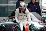 Mercedes driver Lewis Hamilton of Britain walks away from his car after finishing fourth in the qualifying session for the Chinese Formula One Grand Prix at the Shanghai International Circuit in Shanghai, Saturday, April 14, 2018. (AP Photo/Andy Wong)