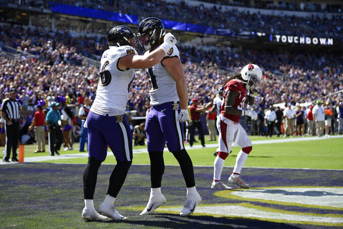 Baltimore Ravens tight end Hayden Hurst, center, celebrates his touchdown with teammate Nick Boyle in the first half of an NFL football game against the Arizona Cardinals, Sunday, Sept. 15, 2019, in Baltimore. (AP Photo/Nick Wass)