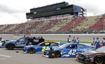 Cars are lined up before a NASCAR cup series auto race at Michigan International Speedway, Monday, June 10, 2019, in Brooklyn, Mich. (AP Photo/Carlos Osorio)