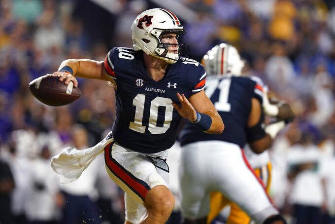 Auburn quarterback Bo Nix (10) scrambles in the first half of an NCAA college football game against LSU in Baton Rouge, La., Saturday, Oct. 2, 2021. (AP Photo/Gerald Herbert)