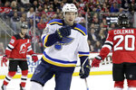 St. Louis Blues center Robert Thomas celebrates after scoring a goal on the New Jersey Devils during the first period of an NHL hockey game Saturday, March 30, 2019, in Newark, N.J. (AP Photo/Julio Cortez)