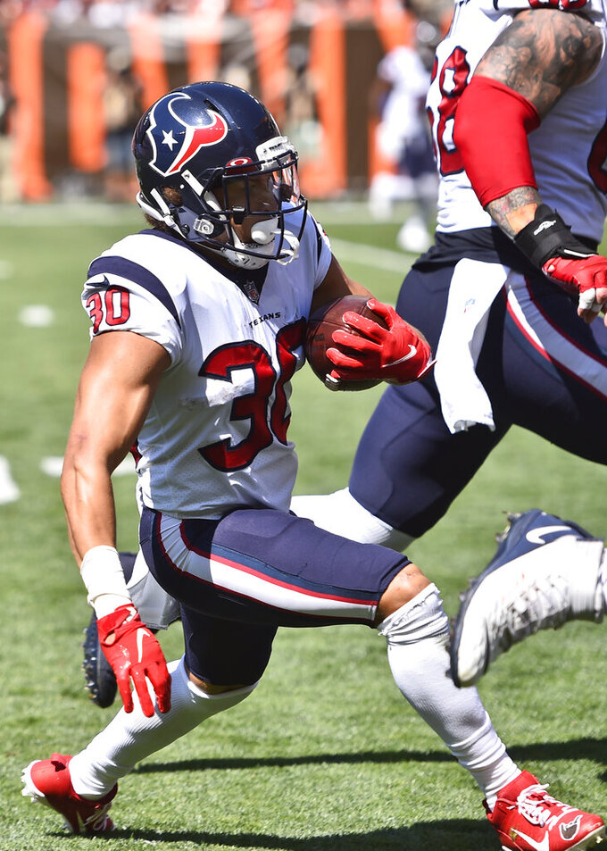Houston Texans running back Phillip Lindsay (30) runs for a 22-yard touchdown during the first half of an NFL football game against the Cleveland Browns, Sunday, Sept. 19, 2021, in Cleveland. (AP Photo/David Richard)