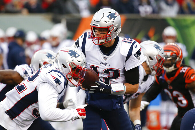 New England Patriots quarterback Tom Brady (12) looks to hand off the ball in the second half of an NFL football game against the Cincinnati Bengals, Sunday, Dec. 15, 2019, in Cincinnati. (AP Photo/Frank Victores)