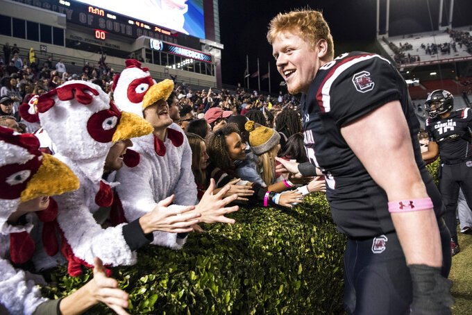 South Carolina offensive lineman Chandler Farrell, right, celebrates with fans after an NCAA college football game against Tennessee, Saturday, Oct. 27, 2018, in Columbia, S.C. (AP Photo/Sean Rayford)