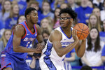 Creighton's Denzel Mahoney, right, is defended by DePaul's Jalen Coleman-Lands (5) during the first half of an NCAA college basketball game in Omaha, Neb., Saturday, Feb. 15, 2020. (AP Photo/Nati Harnik)