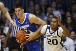 Creighton's Martin Krampelj (15) battles Butler's Henry Baddley (20) for a loose ball during the first half of an NCAA college basketball game, Saturday, Jan. 5, 2019, in Indianapolis. (AP Photo/Darron Cummings)