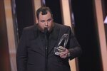 Luke Combs accepts the award for male vocalist of the year at the 53rd annual CMA Awards at Bridgestone Arena, Wednesday, Nov. 13, 2019, in Nashville, Tenn. (AP Photo/Mark J. Terrill)