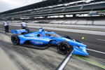 Alex Palou, of Spain, pulls out of the pits during practice for the IndyCar auto race at Indianapolis Motor Speedway, Friday, Aug. 13, 2021, in Indianapolis. (AP Photo/Darron Cummings)
