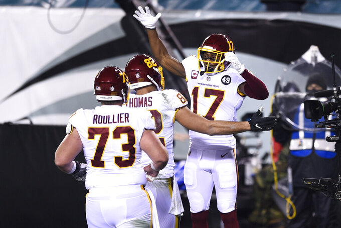 Washington Football Team's Terry McLaurin (17) celebrates with Logan Thomas (82) and Chase Roullier (73) after scoring a touchdown during the first half of an NFL football game against the Philadelphia Eagles, Sunday, Jan. 3, 2021, in Philadelphia. (AP Photo/Derik Hamilton)