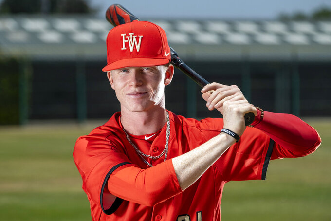 In this June 6, 2019, file photo, Harvard-Westlake's Pete Crow-Armstrong poses for a photo, location not known. Crow-Armstrong and the New York Mets agreed Thursday, June 25, 2020, to a minor league contract with a $3,359,000 signing bonus, the slot value for the 19th overall pick in the amateur draft. (Hans Gutknecht/The Orange County Register via AP, File)
