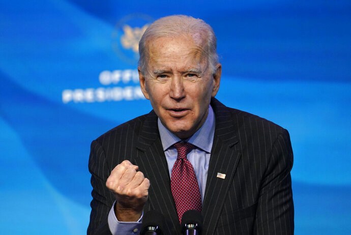 """FILE - In this Friday, Jan. 8, 2021 file photo, President-elect Joe Biden speaks during an event at The Queen theater in Wilmington, Del., to announce key administration posts. U.S. President-elect Joe Biden should bring """"fundamental change"""" to U.S. policy on human rights and allow criminal investigations of President Donald Trump, the head of Human Rights Watch said on Wednesday Jan. 13, 2021. (AP Photo/Susan Walsh, File)"""