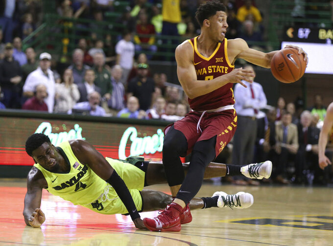 Iowa State guard Lindell Wigginton, right, pulls in a steal over Baylor guard Mario Kegler, left, during the second half of an NCAA college basketball game Tuesday, Jan. 8, 2019, in Waco, Texas. Baylor won 73-70. (AP Photo/Rod Aydelotte)