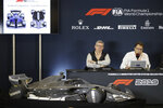 Ross Brawn, left, and Nikolas Tombazis speak during a news conference at the Formula One U.S. Grand Prix auto race at the Circuit of the Americas, Thursday, Oct. 31, 2019, in Austin, Texas. (AP Photo/Darron Cummings)