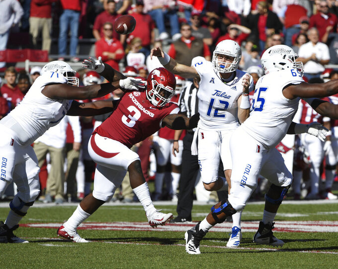 Arkansas defender McTelvin Agim (3) pushes past Tulsa lineman Chris Paul, left, to pressure quarterback Seth Boomer in the first half of an NCAA college football game Saturday, Oct. 20, 2018, in Fayetteville, Ark. (AP Photo/Michael Woods)