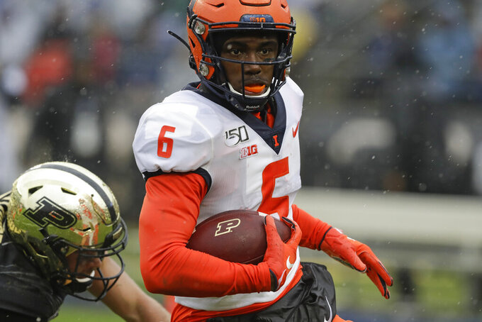 Illinois defensive back Tony Adams (6) runs back an interception for a touchdown during the first half of an NCAA college football game against the Purdue, Saturday, Oct. 26, 2019, in West Lafayette, Ind. (AP Photo/Darron Cummings)
