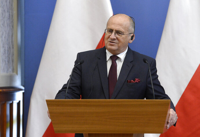 Polish Foreign Minister Zbigniew Rau speaks during his joint press conference with Hungarian Minister of Foreign Affairs and Trade Peter Szijjarto in the Ministry of Foreign Affairs and Trade in Budapest, Hungary, Monday, September 28, 2020. (Lajos Soos/MTI via AP)