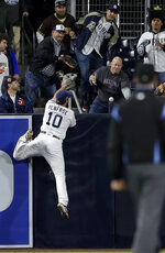 San Diego Padres left fielder Hunter Renfroe can't reach a home run by Arizona Diamondbacks' John Ryan Murphy during the fifth inning of a baseball game Tuesday, May 21, 2019, in San Diego. (AP Photo/Gregory Bull)