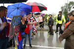 Demonstrators confront police as they try to get onto the Palmetto Expressway, Tuesday, July 13, 2021, in Miami. Demonstrators are protesting in solidarity with the thousands of Cubans who waged a rare weekend of protests around their island nation against the communist regime. (AP Photo/Marta Lavandier)