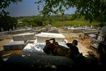 Workers repairing the Jewish cemetery take a break in the shade on top of tombs they already repaired in Guanabacoa, eastern Havana, Cuba, June 12, 2019. The cemetery was inaugurated in 1910 by Jews and their descendants from Central and Eastern Europe, many of whom fled persecution in the period between World Wars I and II. (AP Photo/Ramon Espinosa)