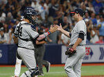 New York Yankees pitcher David Hale celebrates with catcher Gary Sanchez after the Yankees defeated the Tampa Bay Rays 8-4 during a baseball game Thursday, July 4, 2019, in St. Petersburg, Fla. (AP Photo/Scott Audette)