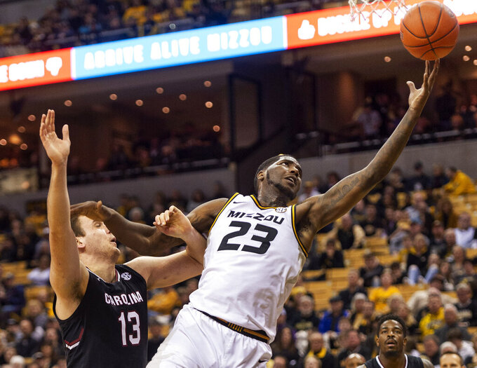 Missouri's Jeremiah Tilmon, right, pulls in a pass in front of South Carolina's Felipe Haase, left, during the second half of an NCAA college basketball game Saturday, March 2, 2019, in Columbia, Mo. Missouri won the game 78-63. (AP Photo/L.G. Patterson)