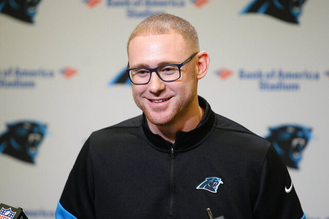 Carolina Panthers NFL football team's new offensive coordinator Joe Brady listens to a question from the media during his introductory press conference at Bank of America Stadium in Charlotte, N.C., Friday, Jan. 17, 2020. (David T. Foster III/The Charlotte Observer via AP)