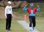 Carolina Panthers' Cam Newton (1) stretches on the sidelines as head trainer Ryan Vermillion watches during the NFL football team's practice in Charlotte, N.C., Wednesday, May 22, 2019. (AP Photo/Chuck Burton)