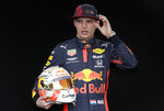 FILE - In this March 12, 2020, file photo, Red Bull driver Max Verstappen of the Netherlands poses for a photo at the Australian Formula One Grand Prix in Melbourne. Four months after the opening race was called off amid last-minute pandemonium the Formula One season finally gets underway this weekend in Austria.(AP Photo/Rick Rycroft, File)
