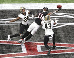 Atlanta Falcons wide receiver Julio Jones can't haul in the fourth-down pass attempt in the end zone as the ball goes off his fingertips with New Orleans Saints cornerback P.J. Williams, left, and safety Marcus Williams, right, defending during the 4th quarter in an NFL football game on Sunday, Dec. 6, 2020, in Atlanta. (Curtis Compton/Atlanta Journal-Constitution via AP)