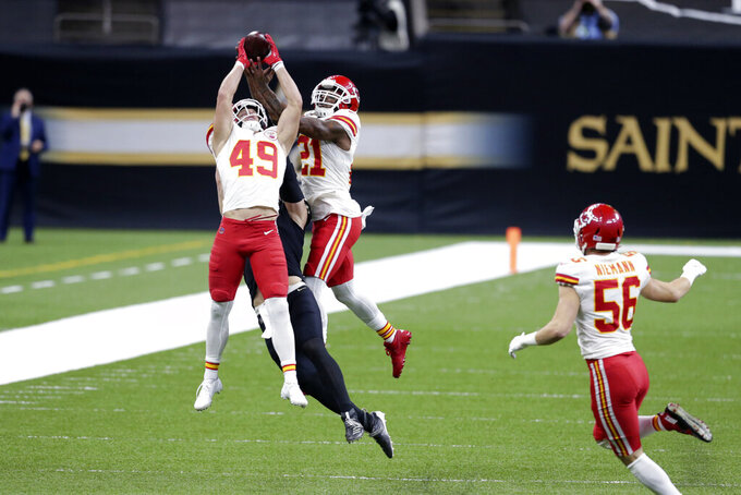 CORRECTS DATE Kansas City Chiefs free safety Daniel Sorensen (49) and cornerback Bashaud Breeland (21) break up a pass intended for New Orleans Saints Taysom Hill in the first half of an NFL football game in New Orleans, Sunday, Dec. 20, 2020. (AP Photo/Butch Dill)