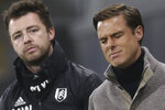 Fulham's manager Scott Parker, right, reacts during the English Premier League soccer match between Fulham and Burnley at the Craven Cottage Stadium in London, Monday, May 10, 2021. (Clive Rose/Pool via AP)