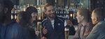 "This undated image provided by Michelob ULTRA shows a scene from the company's 2019 Super Bowl NFL football spot featuring Maluma, center. In the ad for Michelob Ultra, a robot beats humans at different sports like running and spinning. But then he looks longingly in a bar where people are enjoying a post work-out beer. ""It's only worth it if you can enjoy it,"" an on-screen message reads. (Michelob ULTRA via AP)"