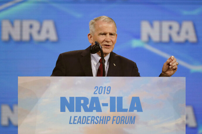 FILE - In this April 26, 2019, file photo, National Rifle Association President Col. Oliver North speaks at the National Rifle Association Institute for Legislative Action Leadership Forum at Lucas Oil Stadium in Indianapolis. New York's attorney general's office is questioning North on Tuesday, Aug. 20, 2019, as it probes whether the NRA broke laws governing its nonprofit status. (AP Photo/Michael Conroy, File)