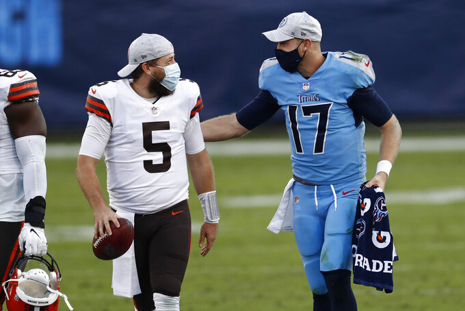 Cleveland Browns quarterback Case Keenum (5) and Tennessee Titans quarterback Ryan Tannehill (17) talk after an NFL football game Sunday, Dec. 6, 2020, in Nashville, Tenn. The Browns won 41-35. (AP Photo/Wade Payne)