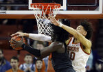 Oklahoma State guard Isaac Likekele (13) is defended by Texas forward Jaxson Hayes (10) as he tries to score during the second half of an NCAA college basketball game, Saturday, Feb. 16, 2019, in Austin, Texas. Texas won 69-57. (AP Photo/Eric Gay)