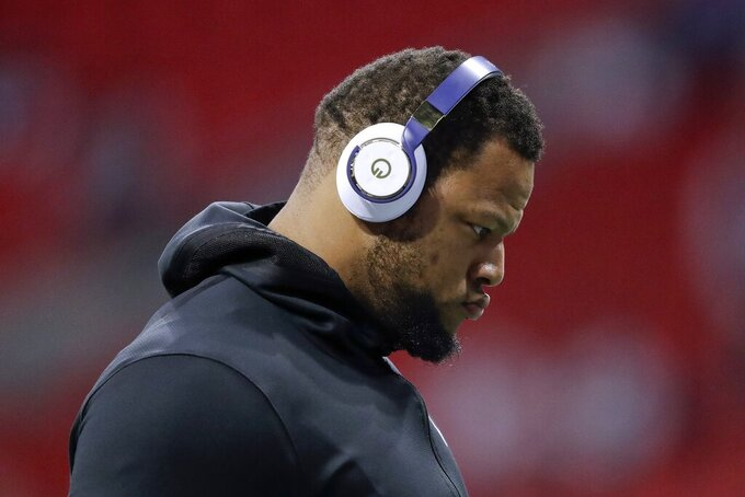Los Angeles Rams' Ndamukong Suh arrives for warm ups before the NFL Super Bowl 53 football game between the Rams and the New England Patriots Sunday, Feb. 3, 2019, in Atlanta. (AP Photo/John Bazemore)