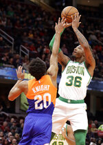 Boston Celtics' Marcus Smart (36) shoots over Cleveland Cavaliers' Brandon Knight (20) in the first half of an NBA basketball game, Tuesday, March 26, 2019, in Cleveland. (AP Photo/Tony Dejak)