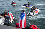 Jet Ski users gathered at San Juan Bay, protesting against Governor Ricardo Rossello, in San Juan, Puerto Rico, Friday, July 19, 2019. Protesters are demanding Rossello step down for his involvement in a private chat in which he used profanities to describe an ex-New York City councilwoman and a federal control board overseeing the island's finance. (AP Photo/ AP Photo/ Dennis M. Rivera Pichardo)
