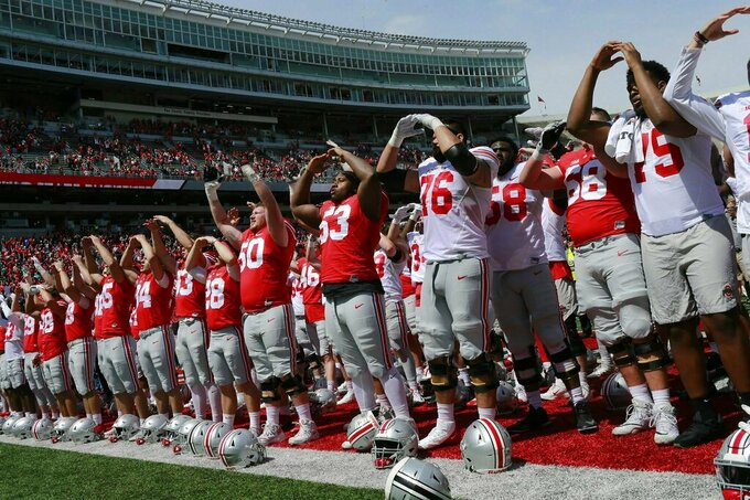 "Ohio State players sing ""Carmen Ohio"" during the spring NCAA college football game at the Ohio Stadium in Columbus, Ohio, Saturday April 13, 2019. (Brooke LaValley/The Columbus Dispatch via AP)"