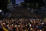 Supporters hold a candlelight rally for beleaguered South Korea's Justice Minister Cho Kuk in front of Seoul Central District Prosecutors' Office in Seoul, South Korea, Saturday, Oct. 5, 2019. (AP Photo/Lee Jin-man)