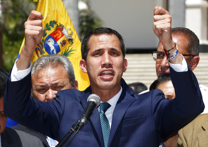 Opposition leader Juan Guaido, who has declared himself the interim president of Venezuela, speaks during a press conference on the steps of the National Assembly in Caracas, Venezuela, Monday, Feb. 4, 2019. Germany, Spain, France, the U.K. and Sweden have announced that they are recognizing Guaido as the country's interim president and are urging him to hold a new presidential election.(AP Photo/Fernando Llano)
