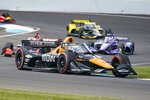 Pato O'Ward, of Mexico, drives through the second turn during the IndyCar auto race at Indianapolis Motor Speedway in Indianapolis, Saturday, Aug. 14, 2021. (AP Photo/Michael Conroy)