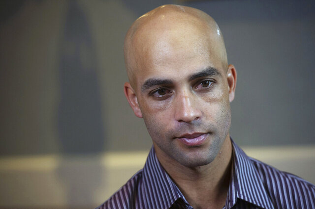 FILE - This is a Sept. 12, 2015, file photo showing former tennis star James Blake discussing his mistaken arrest by the New York City Police Department during an interview in New York. Nearly five years later, Blake says he never suspected the large man running toward him was a plainclothes New York City policeman. But Blake, who is black, had been mistakenly identified as a suspect in a credit card fraud scheme. Video captured the undercover officer grabbing him by the arm, throwing him to the sidewalk face down and handcuffing him.  All of which intensified Blake's reaction to video of George Floyd's death shortly after being detained by Minneapolis police last week. (AP Photo/Bryan R. Smith, File)