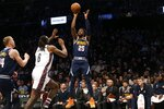 Denver Nuggets guard Malik Beasley (25) puts up a shot against Brooklyn Nets center Deandre Jordan (6) during the first half of an NBA basketball game on Sunday, Dec. 8, 2019, in New York. (AP Photo/Nicole Sweet)
